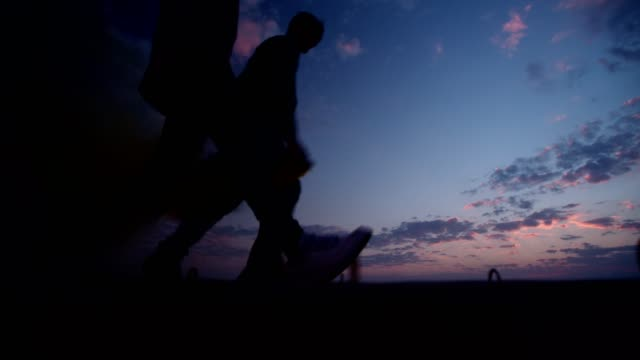 Hipster-friends-holding-smoke-bombs-and-running-after-sunset