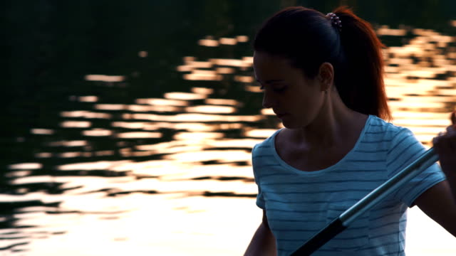 Close-up-Beautiful-Girl-Picks-Oars-Standing-on-Sup