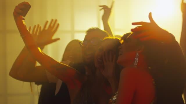 Joyous-Friends-Taking-Selfie-in-Nightclub