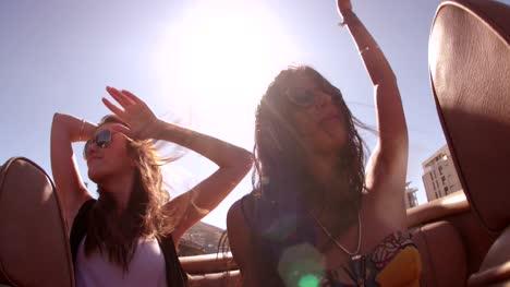 Hipster-boho-girl-friends-enjoys-a-summer-road-trip