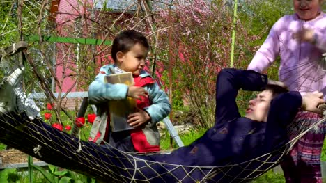 Children-of-different-ages-playing-near-the-hammock