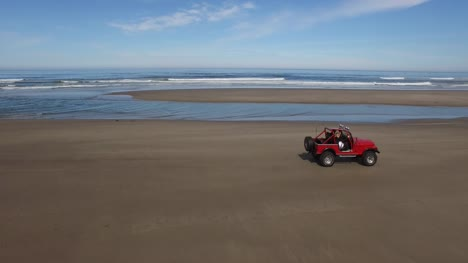 Aerial-shot-of-off-road-vehicle-driving-on-beach