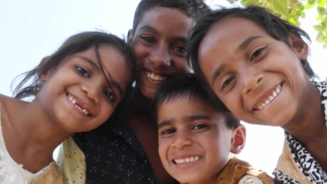 Indian-children-portrait-happy-and-excited-playing-and-making-merry-in-sand-area-in-Rajasthan-state-of-India
