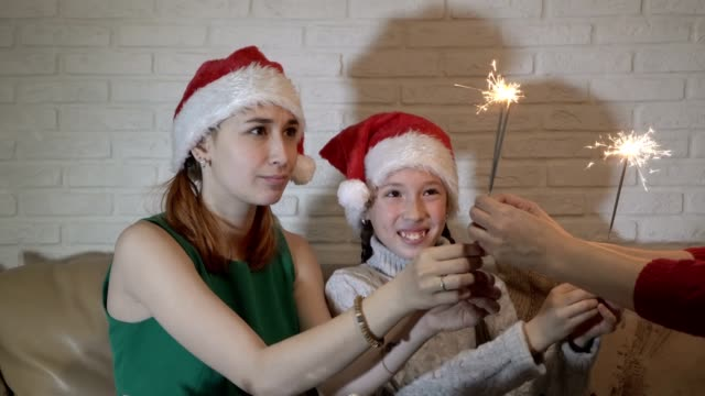 Children-in-hats-Santa-Claus-take-out-of-the-hands-of-my-mother-lit-sparklers-and-smile-
