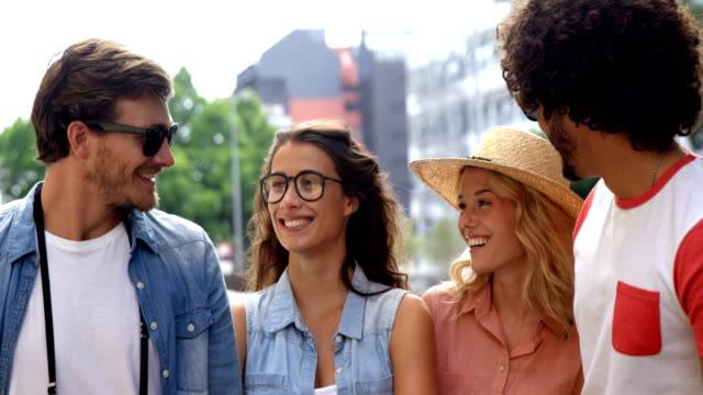 Friends-smiling-while-interacting-with-each-other