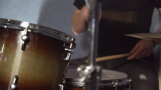 closeup-details-person-playing-on-hi-hat