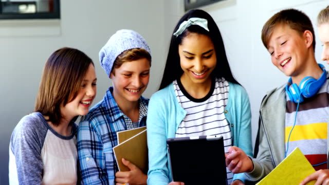 Group-of-students-using-digital-tablet-in-classroom