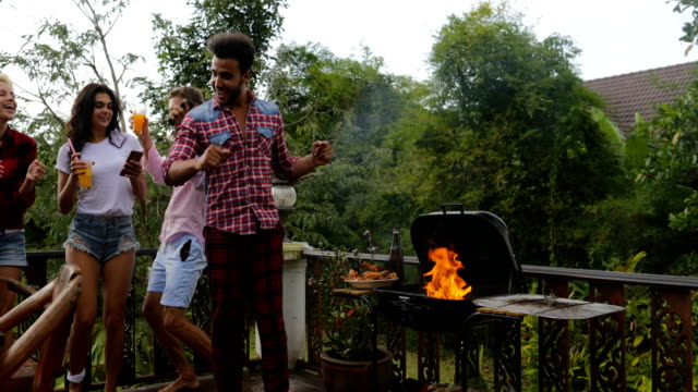 Young-People-Dancing-Cooking-Barbecue-Friends-Group-Cheerful-Gathering-On-Summer-Terrace-Having-Party