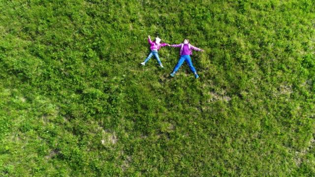 Aerial-shot-of-children-at-green-grass