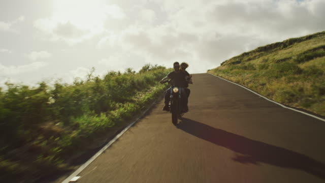 Couple-Riding-Vintage-Motorcycle