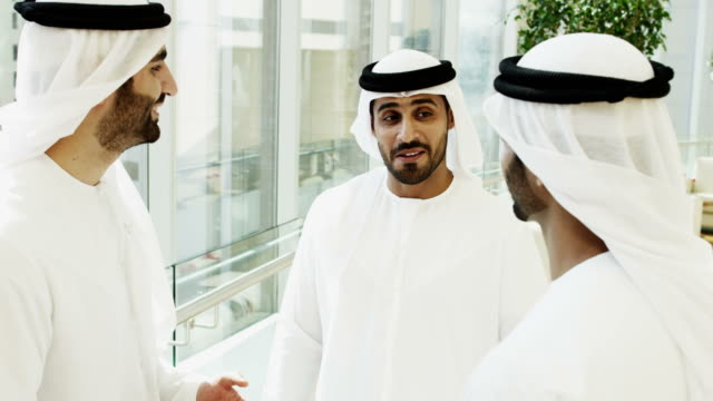 Arab-males-national-dress-meeting-socially-hotel-lobby