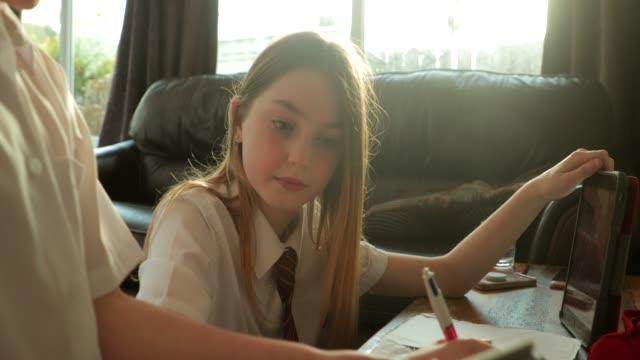 Siblings-doing-Homework