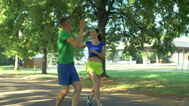 Couple-runners-celebrating-after-finishing-workout