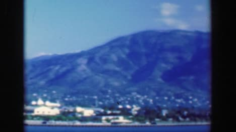 1953:-Tropical-island-steep-cliff-mountains-paradise-city-green-rugged-ecology-