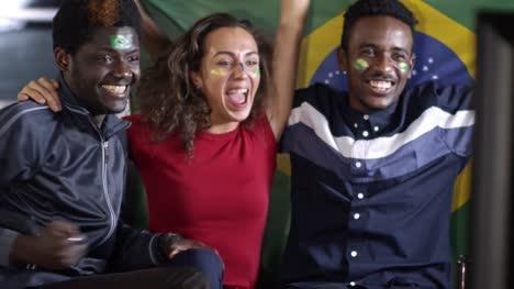 Brazil-Soccer-Fans-Watching-TV-Match-and-Celebrating-Winning