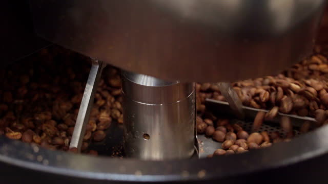 The-coffee-machine-mixing-the-coffee-beans-inside