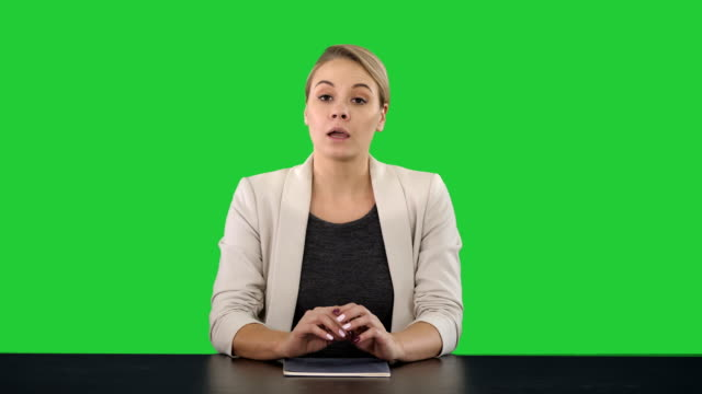 Young-beautiful-television-announcer-giving-a-speach-on-a-Green-Screen-Chroma-Key