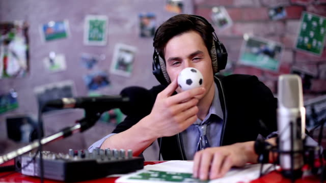 Lazy-sport-event-commentator-(radio-dj)-eats-mini-football
