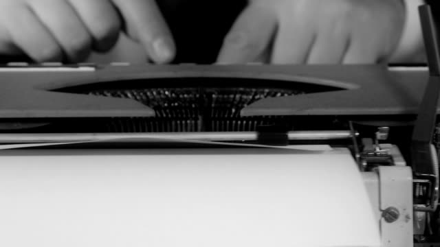 Male-hands-typing-on-a-typewriter