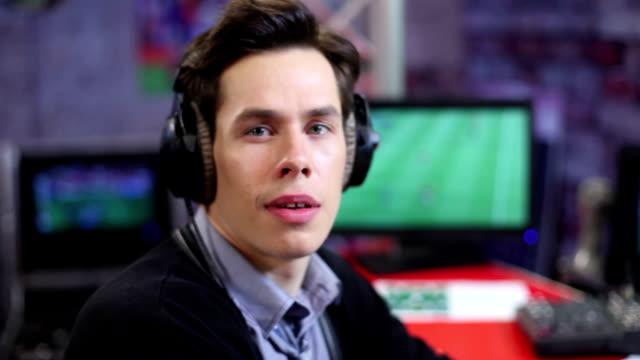 Man-surprised-Radio-Dj-or-event-presenter-takes-off-headphones