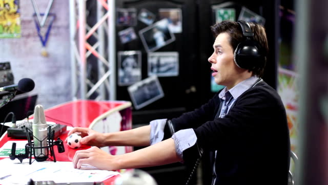 Young-adult-commenting-sport-event-Radio-dj-in-his-room