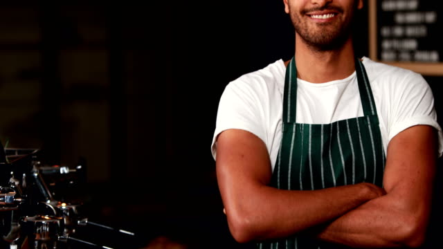 Handsome-waiter-smiling-at-camera