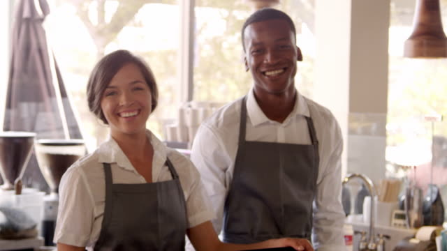Portrait-Of-Male-And-Female-Staff-In-Coffee-Shop-Shot-On-R3D