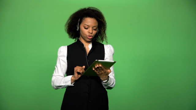 Female-support-call-center-with-tablet-and-headset