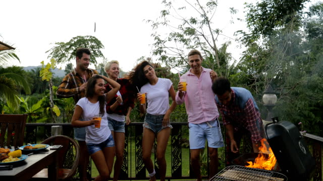 Young-People-Dancing-While-Cooking-Barbecue-Happy-Group-Cheerful-Gathering-On-Summer-Terrace-Having-Party