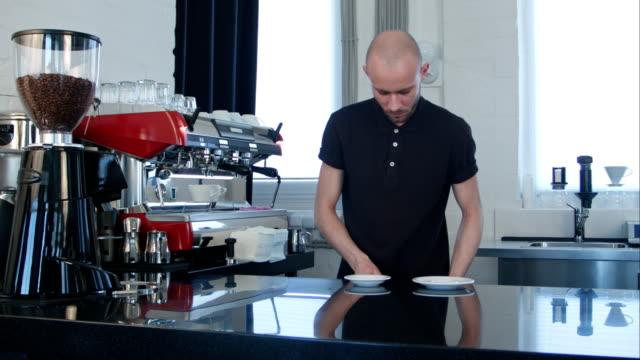 Barista-prepares-cappuccino-in-coffee-shop
