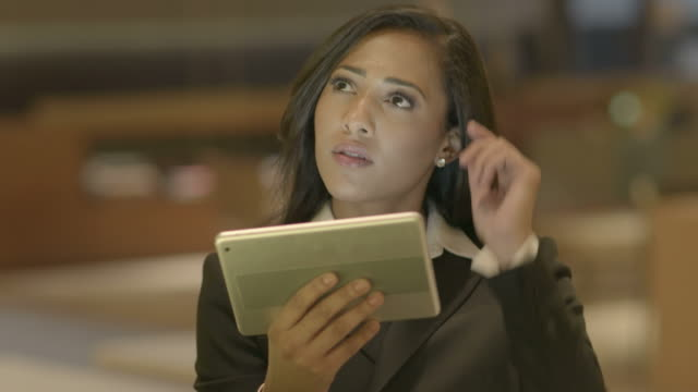 Young-Attractive-Black-Women-Using-Tablet-Computer-Searching-the-Web-Online-African-American-Female-in-Business-Suit-Connecting-with-Social-Media-Urban-Lifestyle-Background