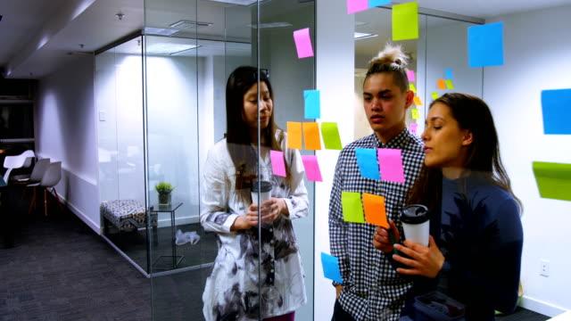Executives-reading-stick-notes