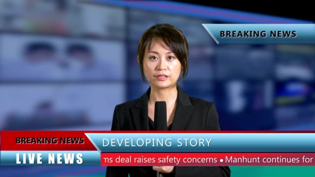 Asian-American-news-anchor-in-studio-with-lower-thirds-Live-news-concept