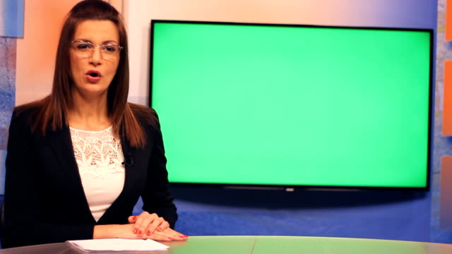 Young-woman-TV-presenter-Green-Screen-background