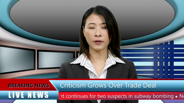 Asian-TV-News-presenter-in-Television-Studio-with-lower-thirds