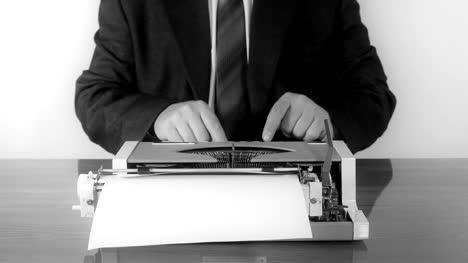 Man-typing-on-a-manual-typewriter