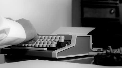 Smoking-journalist-typing-on-a-portable-typewriter