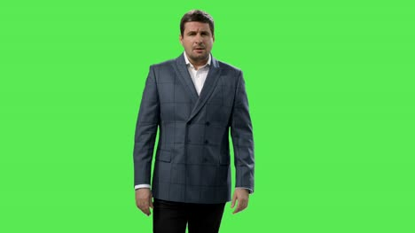 Media-reporter-is-talking-about-weather-on-a-mock-up-green-screen-in-the-background-