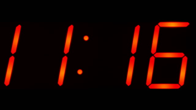 Time-showing-between-11:00-and-11:59-on-big-digital-clock