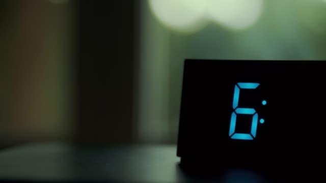 dolly-shot-of-alarm-clock-turns-7-AM
