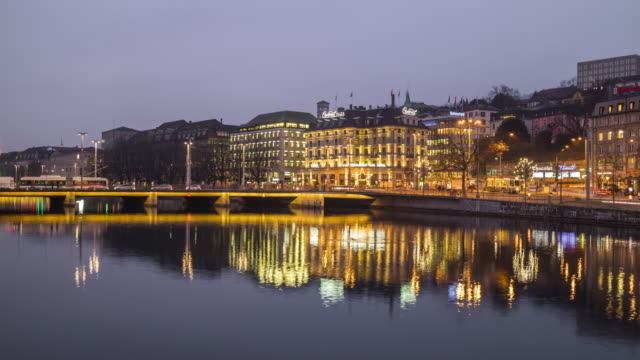 switzerland-zurich-twilight-night-light-limmat-river-traffic-street-panorama-4k-time-lapse