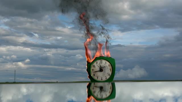 Burning-old-retro-green-alarm-clock-on-mirror-in-space