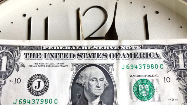 close-up-f-us-dollar-banknote-with-clock-background-