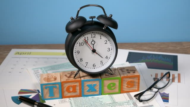 Income-tax-deadline-approaching-with-alarm-clock