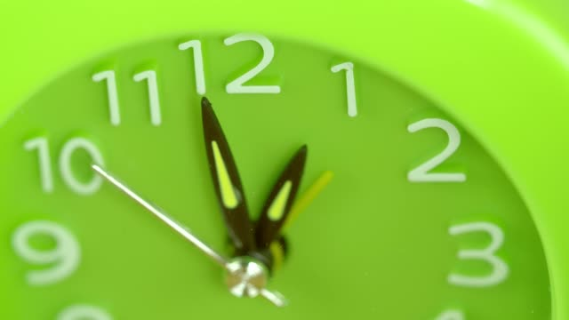 close-up-hands-running-on-green-clock--Time-symbol-hurry
