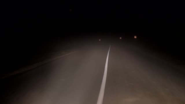 In-Driving-A-Car-On-Road-At-Night-In-Heavy-Fog-And-Poor-Visibility-On-The-Turn