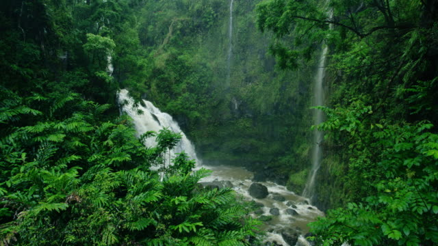 Amazing-waterfall-in-tropical-rain-forest-on-the-road-to-Hana-in-Maui-Hawaii