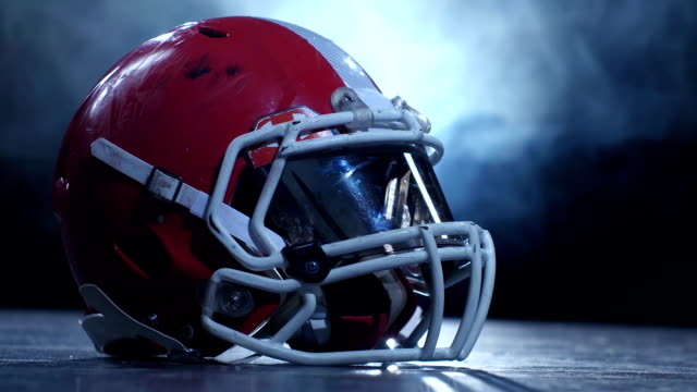Helmet-american-football-players-in-the-smoke-background-Clous-up