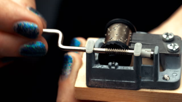 Detailed-view-of-the-insides-of-an-old-vintage-music-box-as-it-plays-Slow-tracking-movements