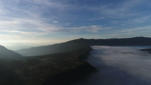 Aerial-view-flight-over-Cemoro-Lawang-small-village-in-morning-mist